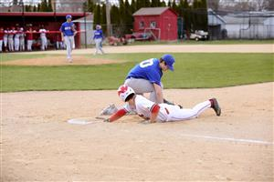 Charger slding safely into first base.